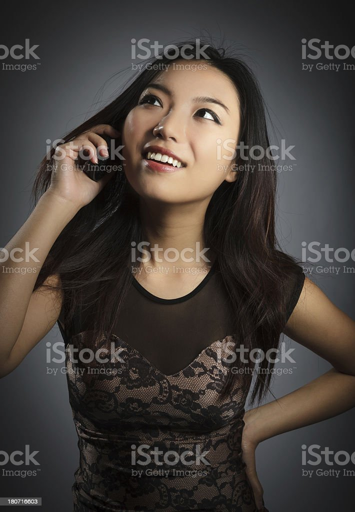 Portrait attractive asian girl in evening dress isolated on grey royalty-free stock photo