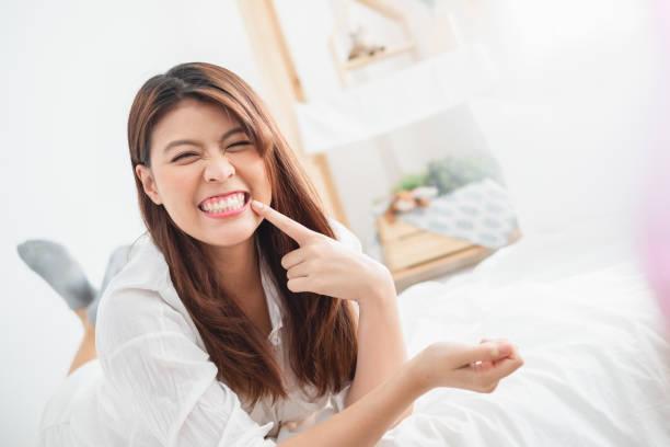 Portrait beautiful Asian woman showing perfect white teeth stock photo