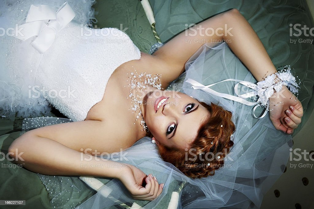Portrait beautiful bride lying on bed royalty-free stock photo