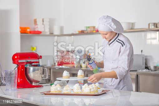 Portrait beautiful chef home cook dessert cupcakes homemade sweets baking