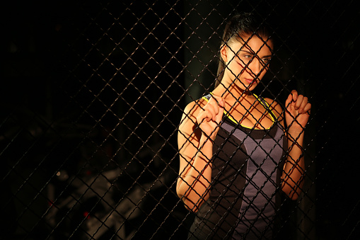 629605142 istock photo Portrait beautiful fitness girl near fence of grid in gym 502814418