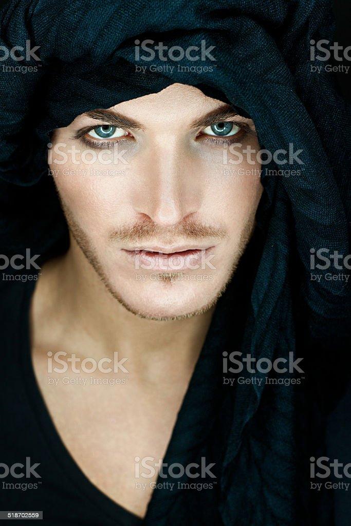 Portrait beautiful man with black scarf stock photo