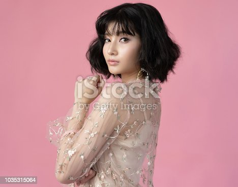 istock Portrait beautiful woman asian with clean skin, natural make-up,pink background 1035315064