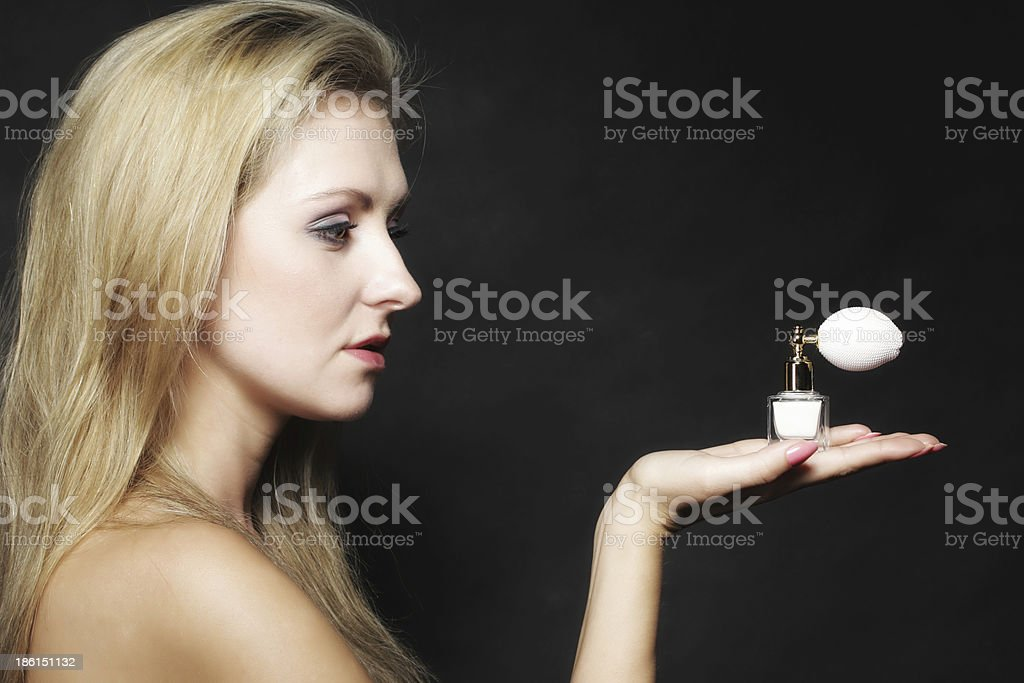 portrait beautiful woman with perfume bottle royalty-free stock photo