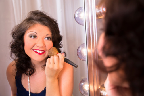 109721176 istock photo Portrait:  Beautiful young woman's reflection in a hollywood make-up mirror. 476399965
