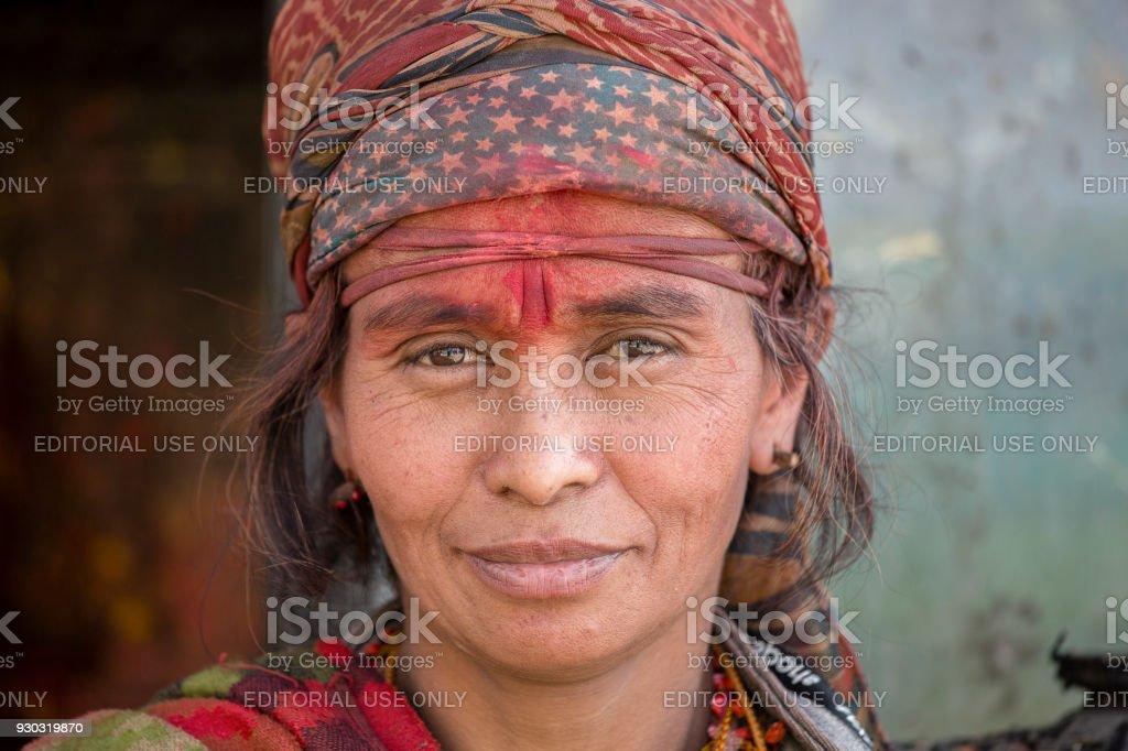 Portrait beggar woman in poor clothes in street Kathmandu, Nepal stock photo