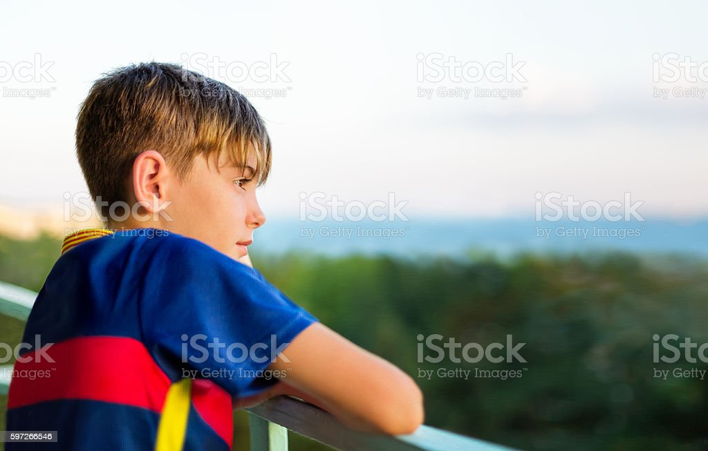 Portrait boy looking into the distance against the sea royalty-free stock photo