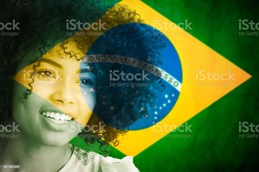 portrait Brazilian woman with flag stock photo
