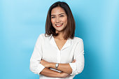 istock portrait business woman asian on blue background 1214744769