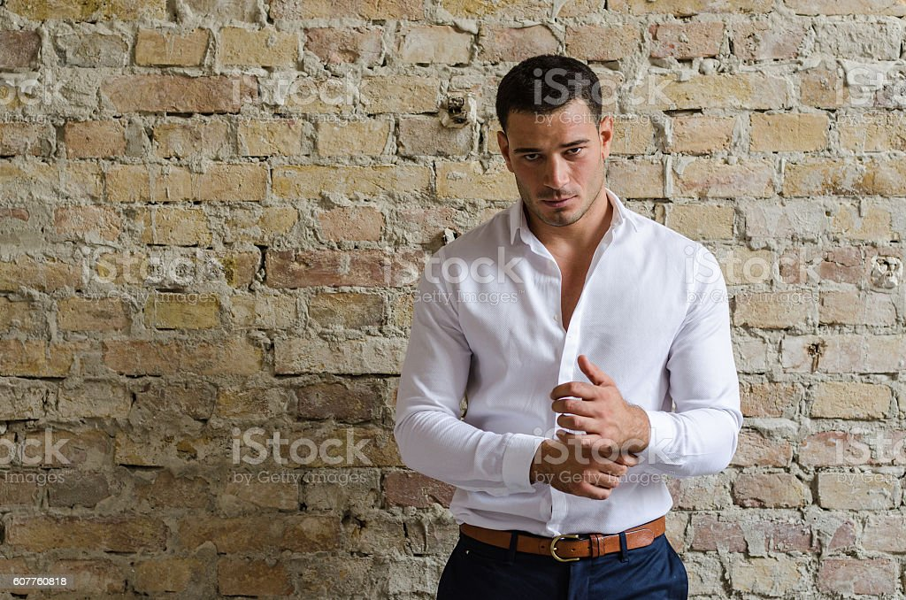 Portrait businessman posing in front of the old wall stock photo