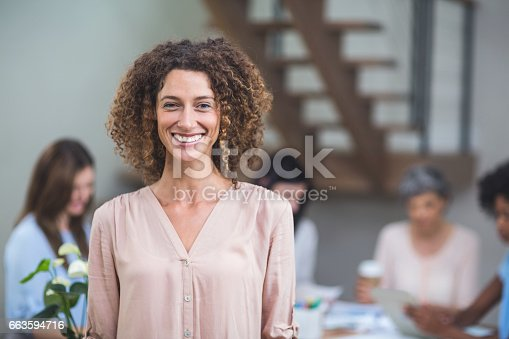 Portrait businesswoman smiling in office