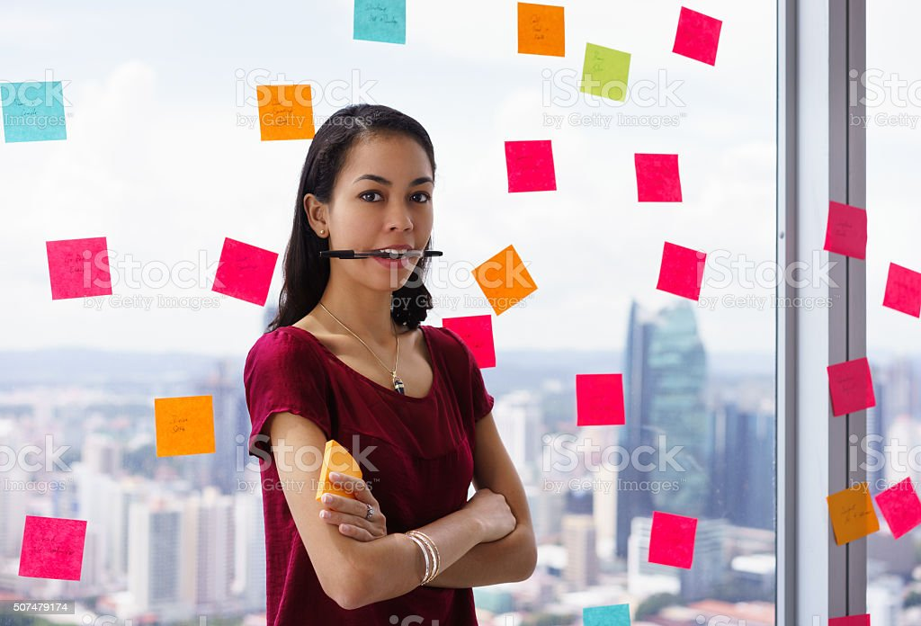 Portrait Busy Person With Many Sticky Notes On Office Window stock photo