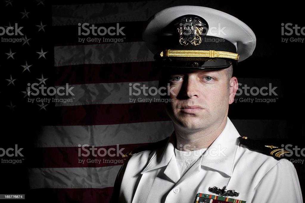 Portrait Caucasian Sailor Wearing White Uniform  American Flag Background royalty-free stock photo