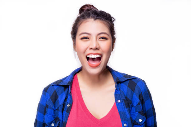 Portrait cheerful woman. Pretty asian woman laughing something. Attractive beautiful young lady get happiness. Beautiful girl has whitening teeth and nice braces. She has breath freshener. isolated stock photo