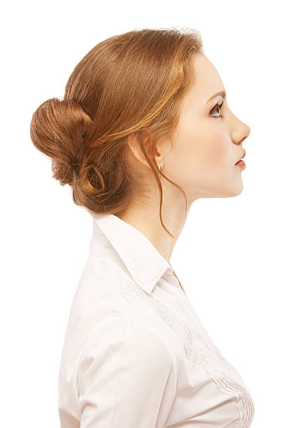 portrait close up of young woman - profile view stock photos and pictures