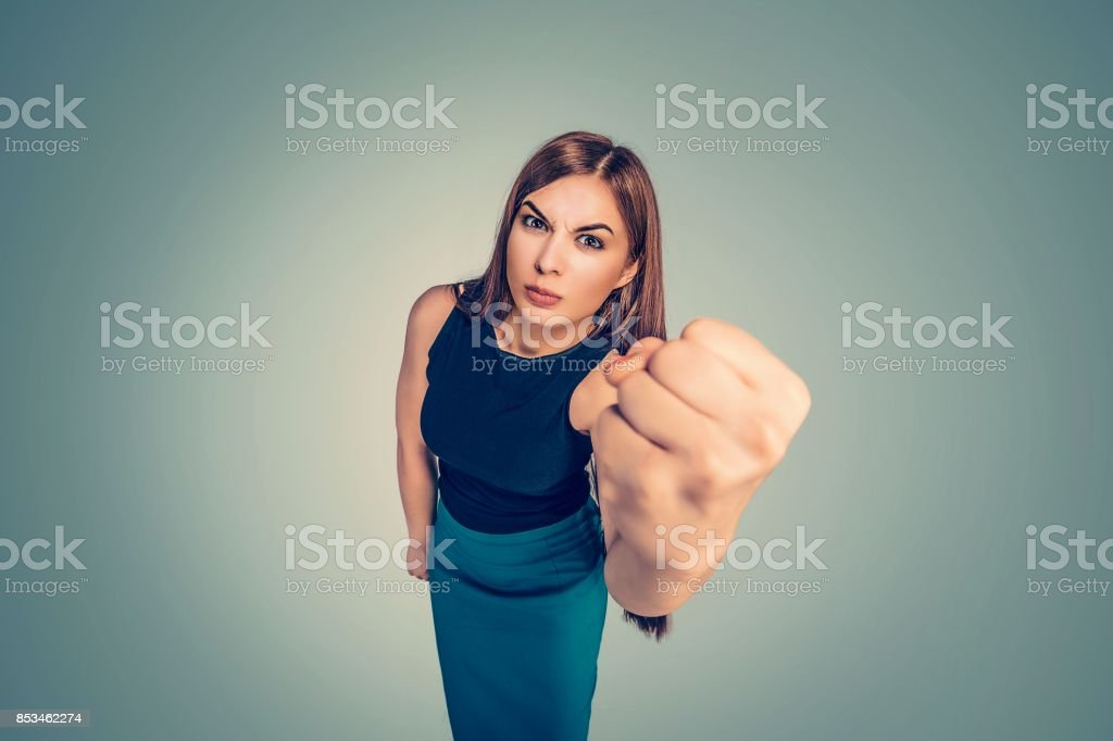 Portrait closeup beautiful smile latina graduate graduated student girl young woman in cap gown showing thumbs up holding diploma scroll isolated green background wall. Celebrating graduation ceremony stock photo