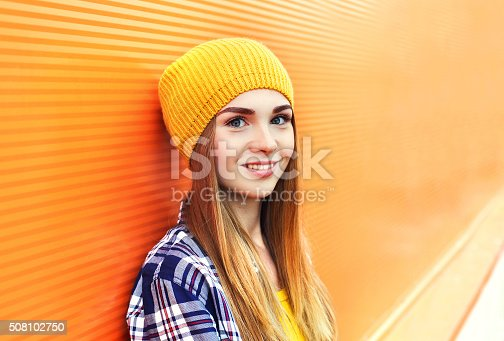 istock Portrait closeup beautiful young girl in yellow hat over colorful 508102750