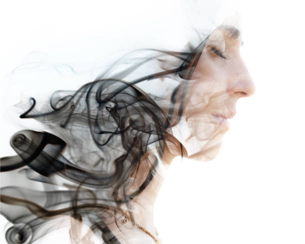 A portrait combined with a photograph of the smoke. stock photo