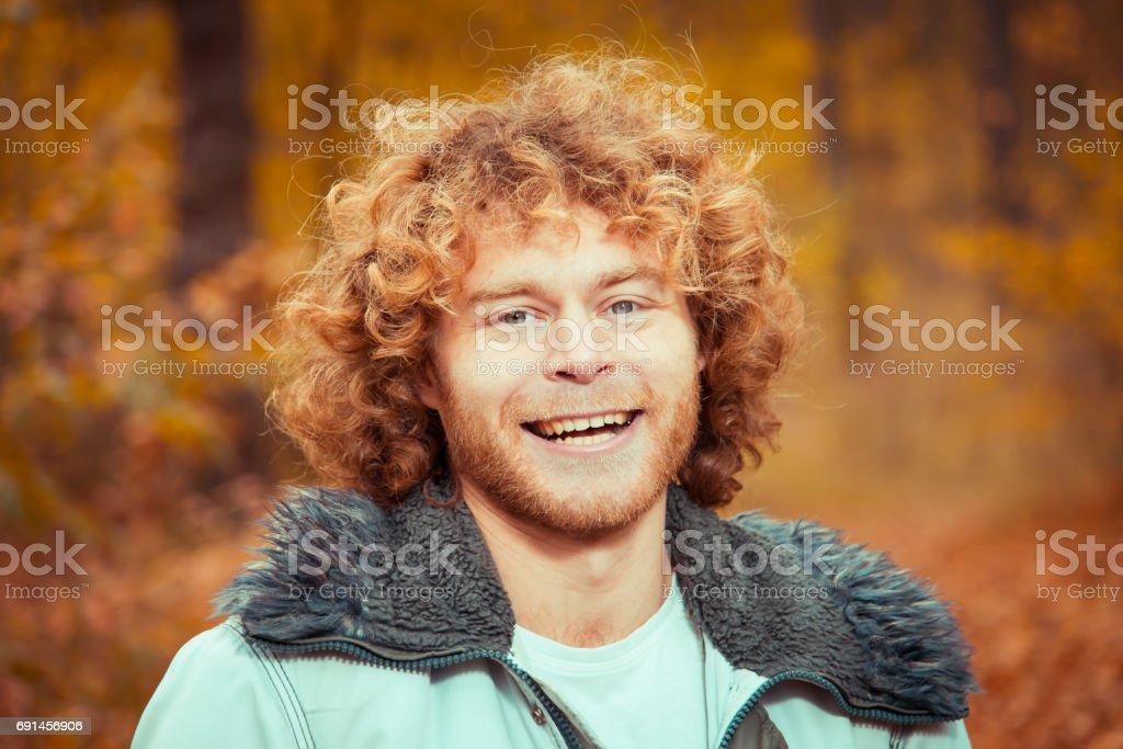 Portrait. Curly guy. Emotions joy. stock photo