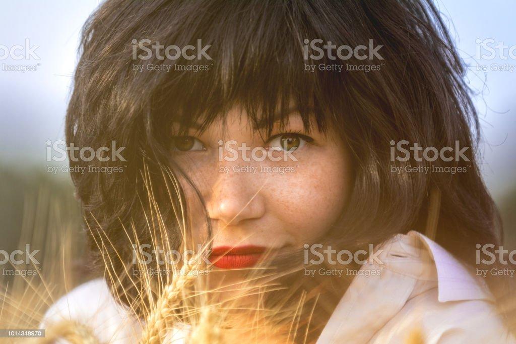 Portrait cute happy beautiful female brunette with red lipstick stock photo