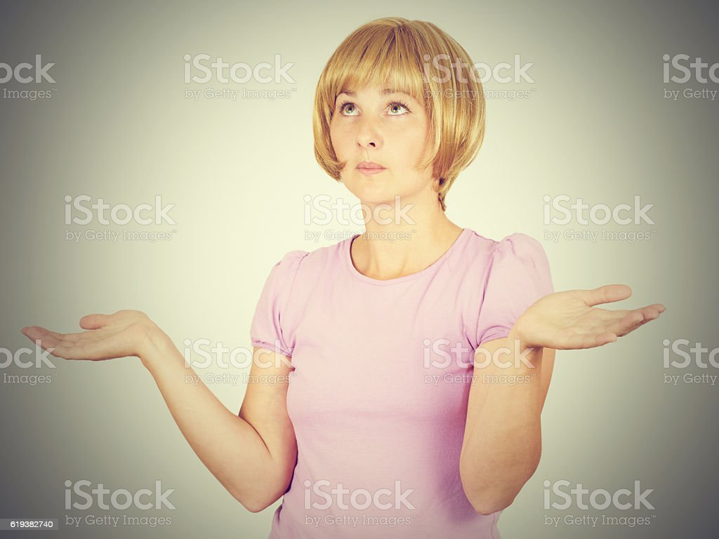 Portrait dumb looking woman arms out shrugs shoulders. stock photo