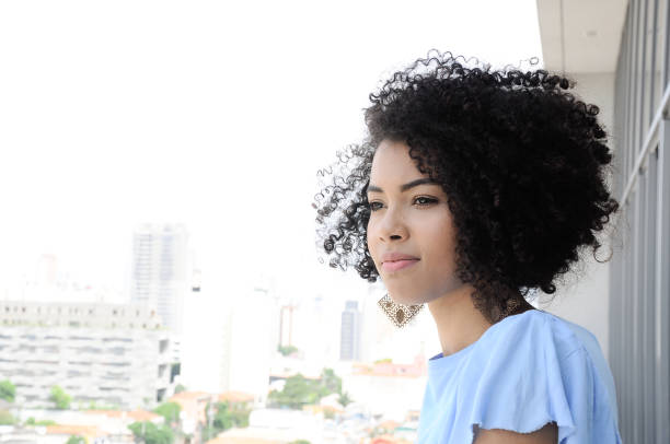 Portrait enthusiastic young woman with curly black afro looking up : Stock Photo Comp Add to Board Portrait enthusiastic young woman with curly black afro stock photo