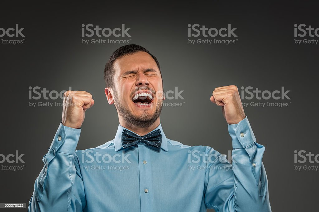 Portrait excited, happy man, arms up fists pumped celebrating su stock photo