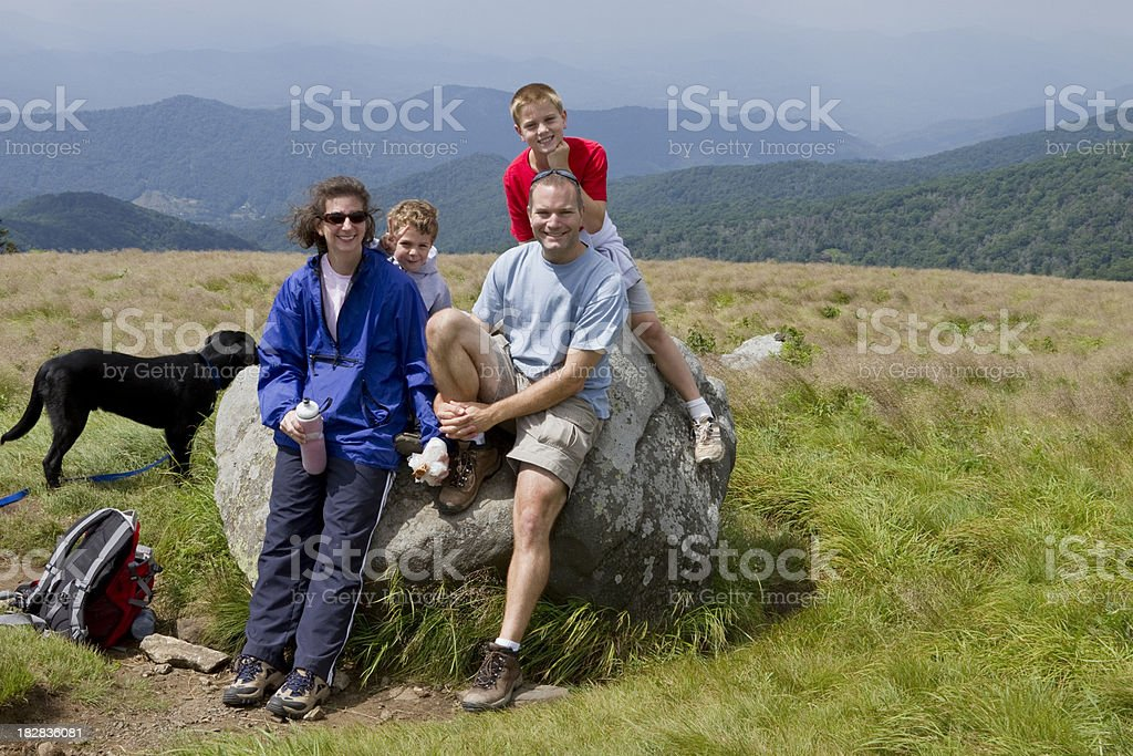 Portrait, Family Of Four & Dog, Grassy Mountain Top Hike royalty-free stock photo