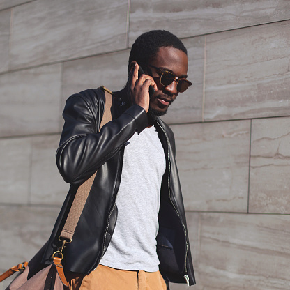 627398448 istock photo Portrait fashion confident african man talking on smartphone in city 627399200