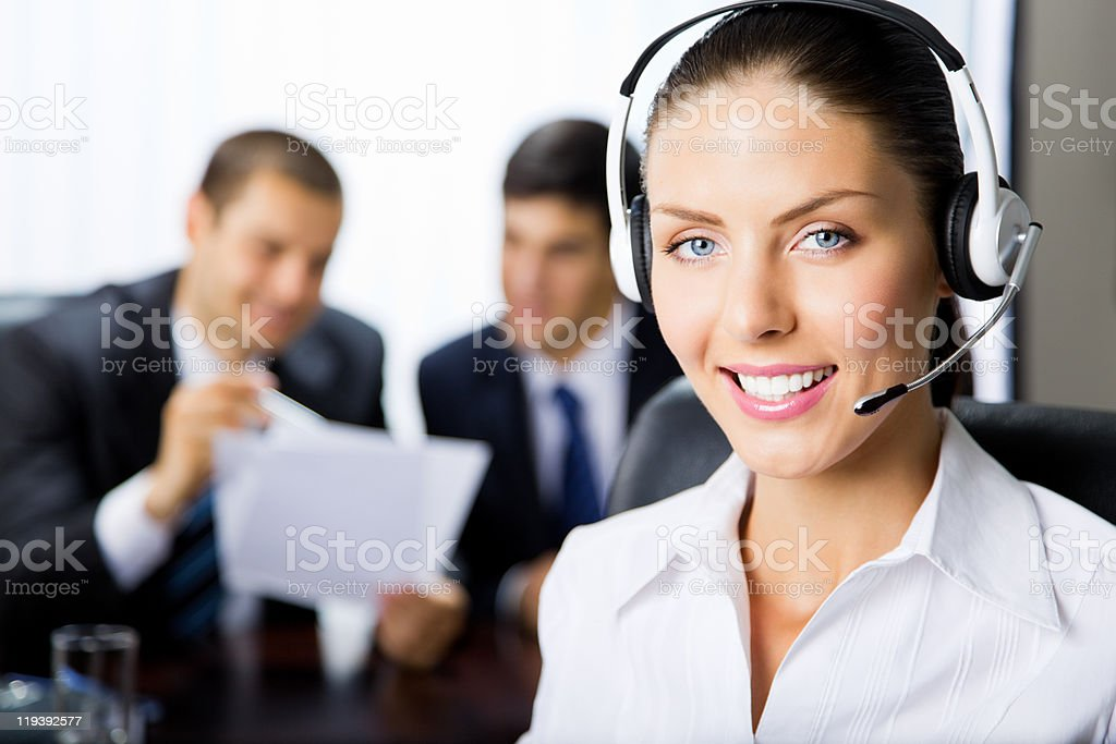 Portrait female support phone operator at workplace stock photo