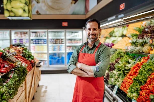 Portrait fo Latino employee in supermarket stock photo