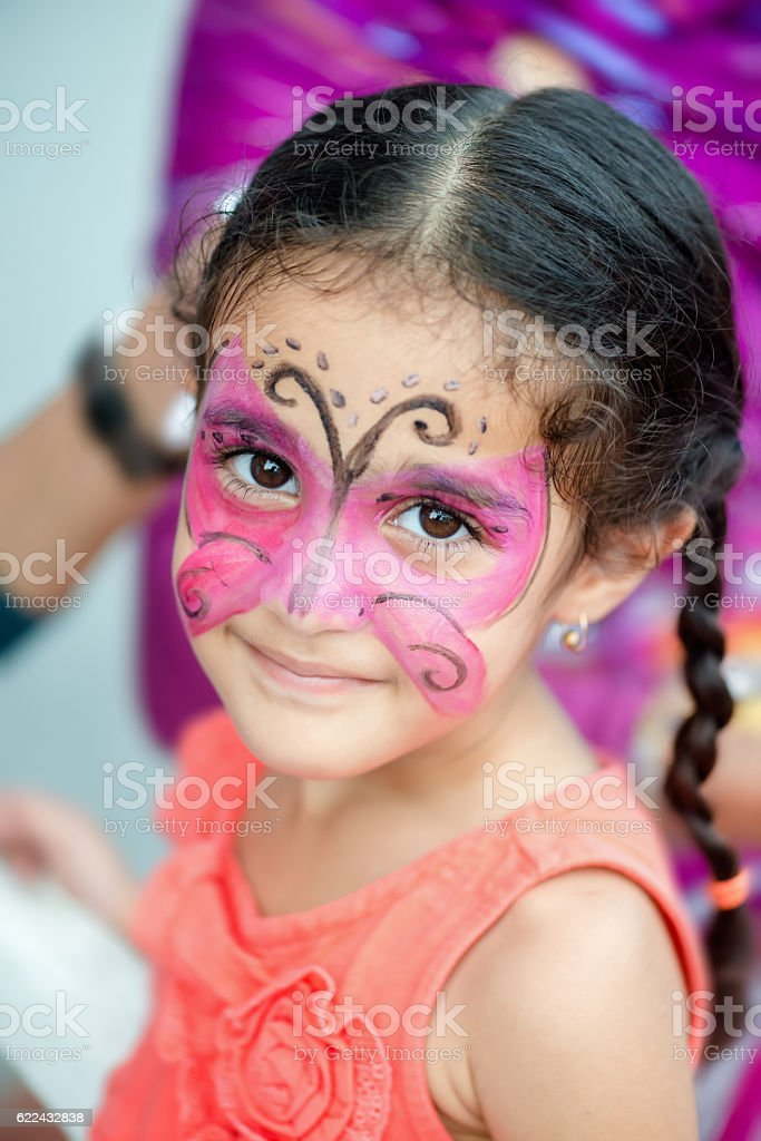 Portrait four year old cute girl child young face painted stock photo