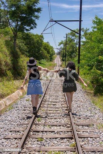 istock portrait friends on train line 1306388584