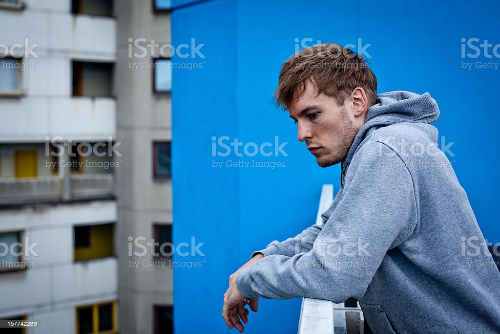 portrait from a handsome young man in urban location royalty-free stock photo