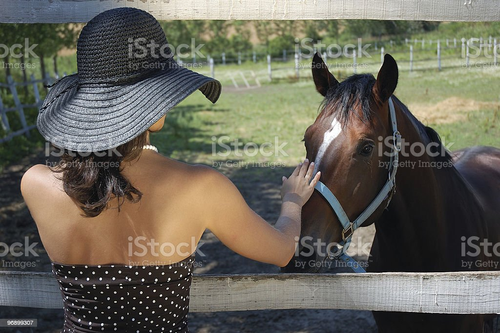 Portrait from a young woman with horse royalty-free stock photo
