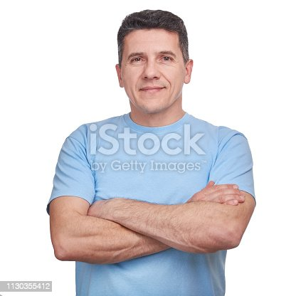 istock Portrait handsome man wearing blue informal t-shirt with folded arms isolated 1130355412