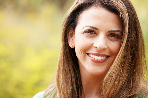 Portrait hispanic woman outdoors Portrait hispanic woman outdoors smiling at camera one mature woman only stock pictures, royalty-free photos & images
