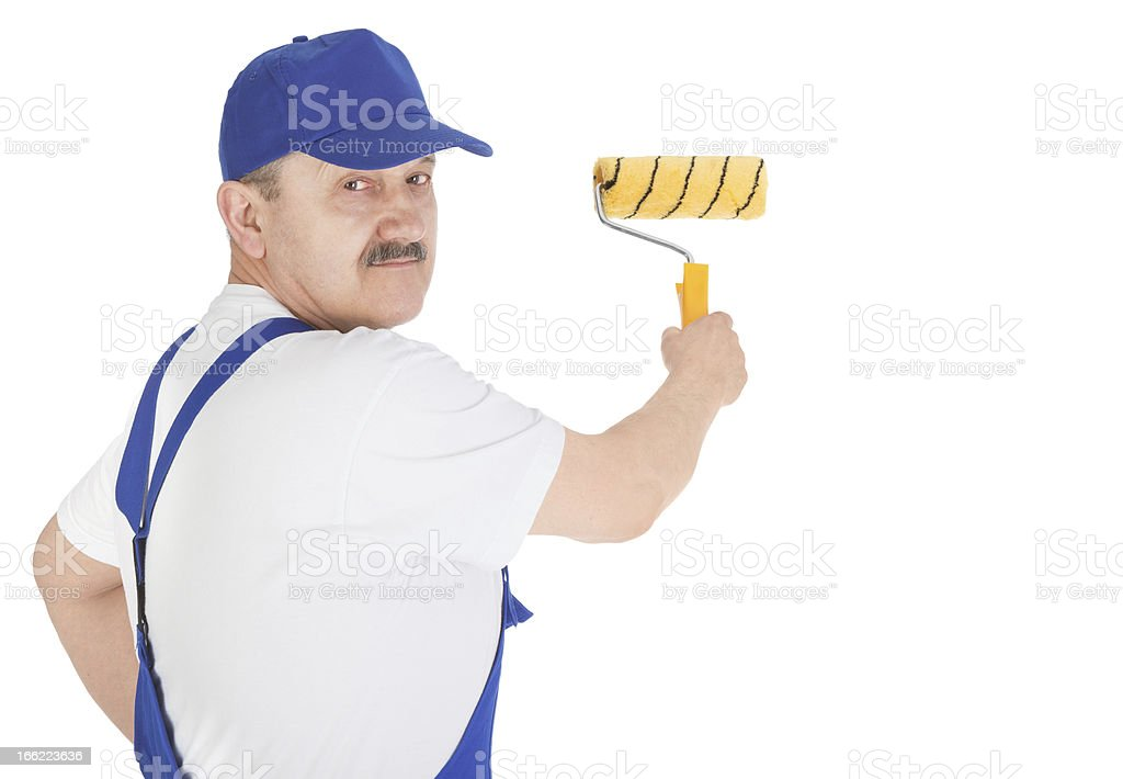 Portrait house painter is painting invisible wall royalty-free stock photo
