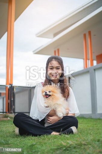 istock Portrait image, Teen woman playing with pomperanian dog in the home, aisan woman 1163388259