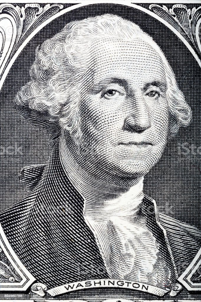 Portrait in macro of Washington's Face on a one dollar bill stock photo