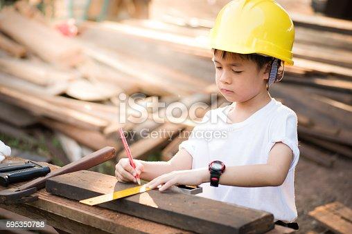 istock portrait kids carpenter concept 595350788