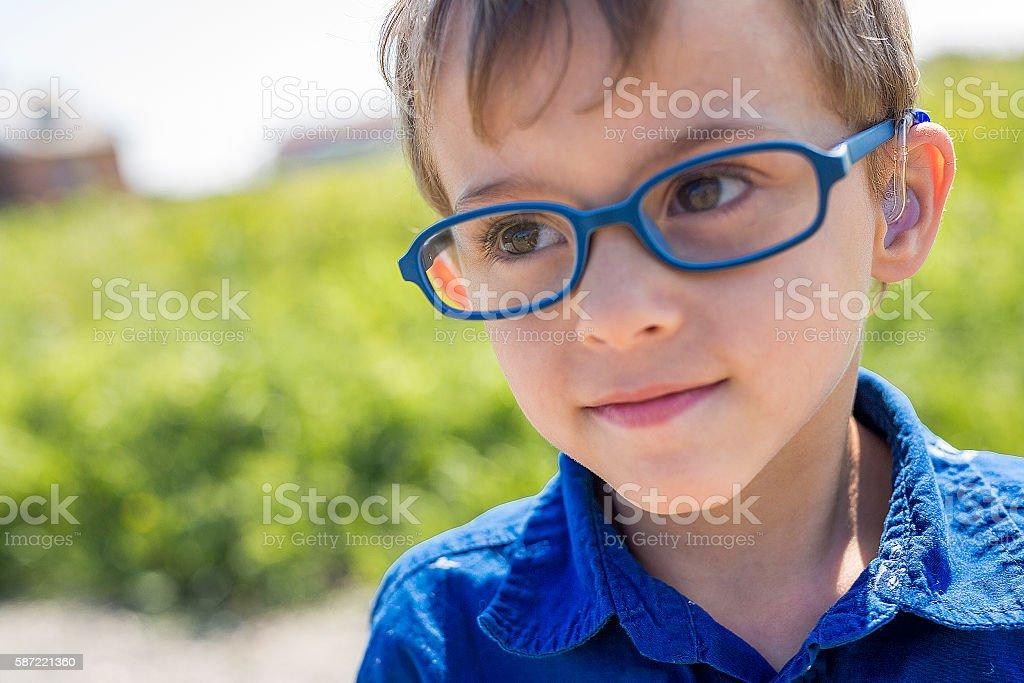 Portrait little boy outdoor stock photo