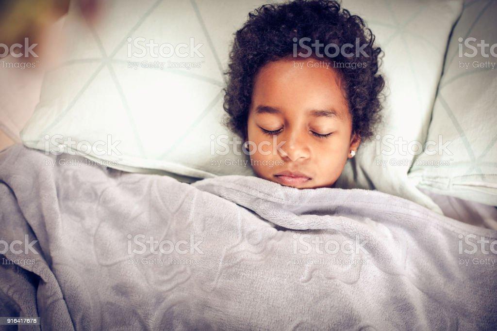 Portrait little girl in bed. stock photo