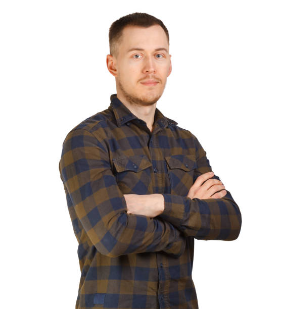 Portrait man in a checkered shirt, arms crossed on chest. Isolated on white background stock photo