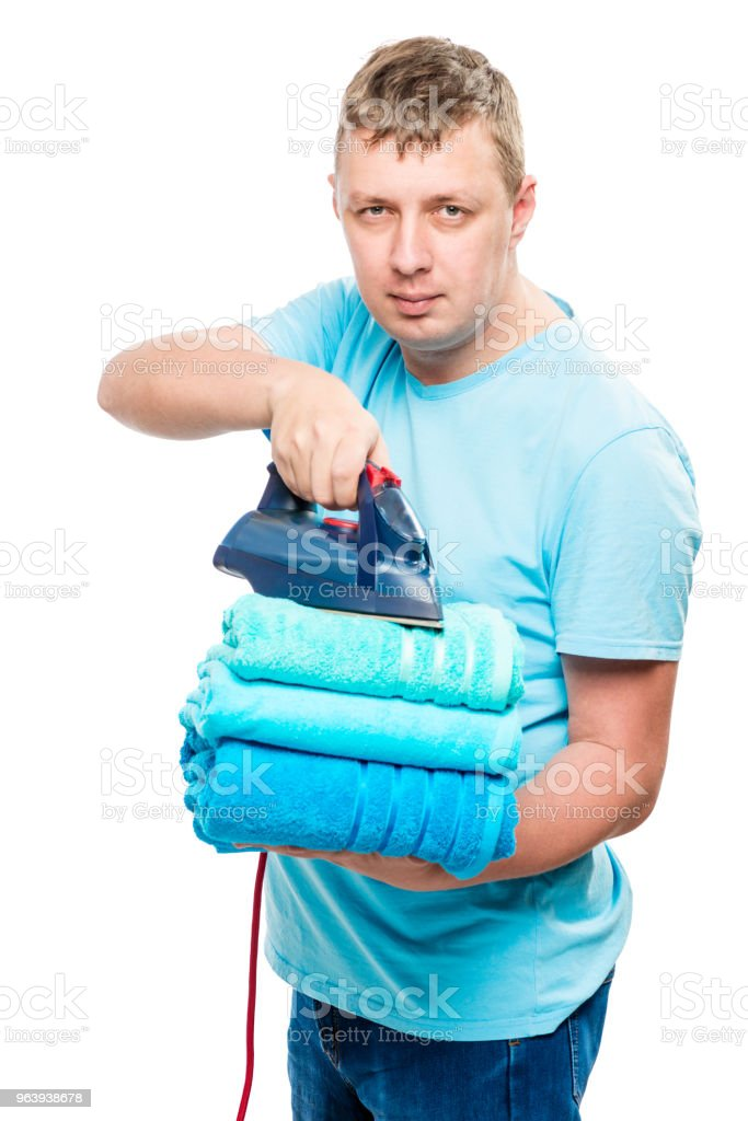 portrait man with iron and a pile of ironed towels isolated - Royalty-free Adult Stock Photo