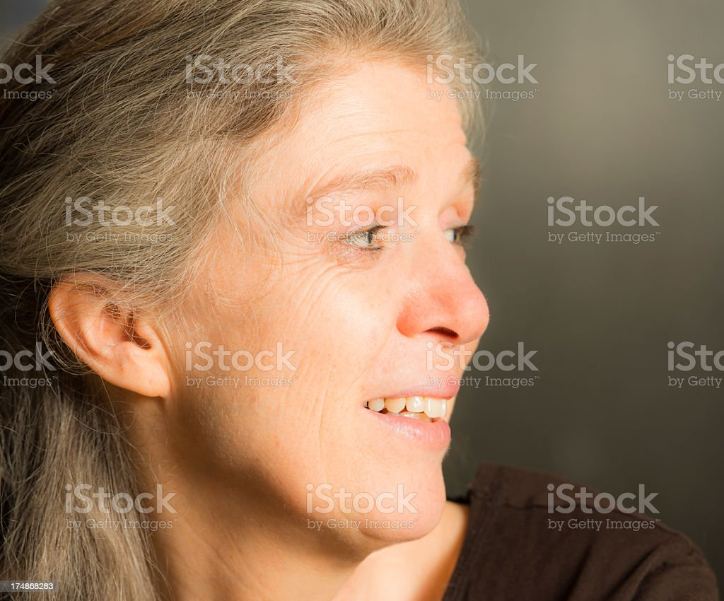 Portrait mature woman toothy smile content candid casual royalty-free stock photo