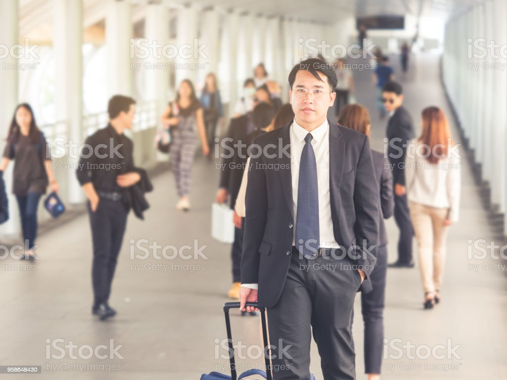Portrait middle aged asian businessman 40s in the city, businessman,...