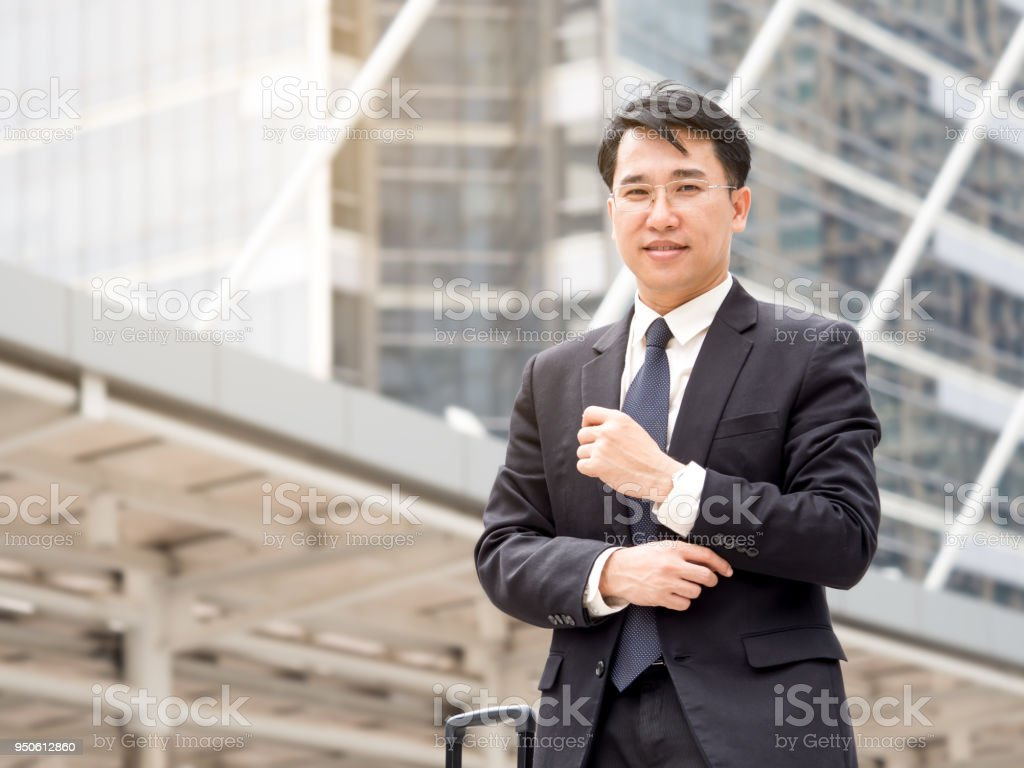 Portrait middle aged asian businessman in the city, businessman,...