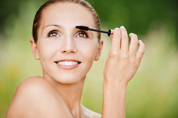 portrait naked woman combs brow brush stock photo