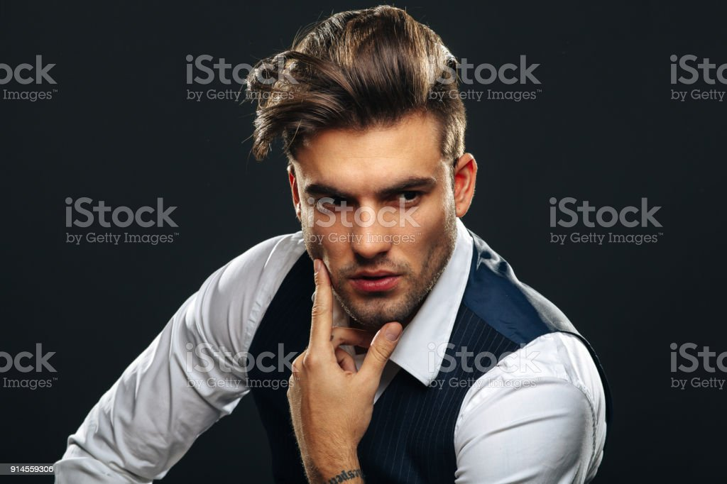 Portrait od handsome man in studio on dark background stock photo